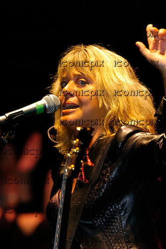 Suzi Quatro - 1970's female singer and bass player from Detroit Michigan performing live at at the Les Gray Memorial concert held at the Apollo Hammersmith, London UK - 25 Aug 2004.  Photo by: George Chin/IconicPix