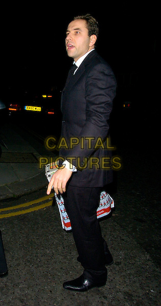 DAVID WALLIAMS.Sharon Osbourne's Christmas Party, 30 Pavillion Road, London, UK..December 19th, 2006.full length black coat suit Hamley's bag.CAP/CAN.©Can Nguyen/Capital Pictures