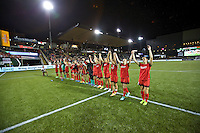 Portland, Oregon - Sunday April 17, 2016: The Portland Thorns FC salute the fans. The Portland Thorns play the Orlando Pride during a regular season NWSL match at Providence Park. The Thorns won 2-1.