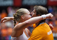 The Netherlands, Den Bosch, 20.04.2014. Fed Cup Netherlands-Japan,Kiki Bertens (NED) puts The Netherlands in the lead 2-1, and is embraced by captain Paul Haarhuis<br /> Photo:Tennisimages/Henk Koster