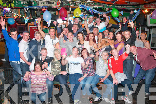 KEY TO THE DOOR: Jason O'Shea, Gallowsfield, Tralee (seated centre) having a blast celebrating his 21st birthday last Saturday night in the Huddle bar, Strand Rd, Tralee with many friends and family.