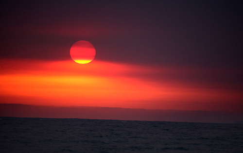 The sun sets over the Pacific Ocean near Los Angeles, California