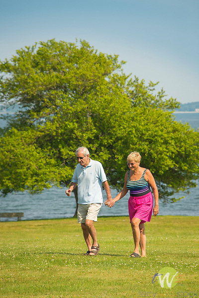Harkness Memorial State Park. Elderly couple holding hands and walking.