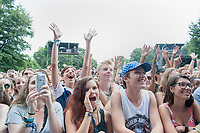 Fans of singer Melanie Martinez sing along with the artist on Sunday afternoon at Music Midtown in Atlanta.