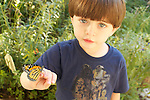Sawyer Kuhlken with a newly hatched monarch that landed on his hand in the backyard in Austin