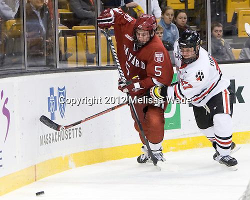 Dan Ford (Harvard - 5), Alex Tuckerman (Northeastern - 27) - The Harvard University Crimson defeated the Northeastern University Huskies 3-2 in the 2012 Beanpot consolation game on Monday, February 13, 2012, at TD Garden in Boston, Massachusetts.