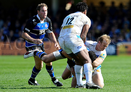02.04.2011 Aviva Premiership Rugby. Bath v Exeter Chiefs from The Recreation Ground. Bath Inside Centre (#12) Shontayne Hape is tackled by Exeter Chiefs Winger (#11) Nic Sestaret and Inside Centre (#12) Sireli Naqelevuki in the second half.