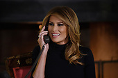 First Lady Melania Trump participates in NORAD Santa Tracker phone calls in the East Room of the White House in Washington, D.C on December 24, 2018.<br /> Credit: Olivier Douliery / Pool via CNP