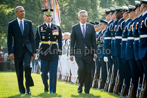 United States President Barack Obama and Prime Minister Lee Hsien Loong of Singapore review the troops during official welcoming ceremonies on the South Lawn of the White House in Washington, DC on August 2, 2016. Lee is on a State Visit to the United States. Photo Credit: Pete Marovich/CNP/AdMedia