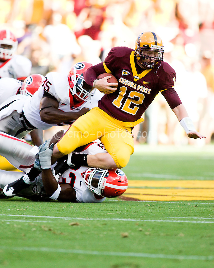 Sept 20, 2008; Tempe, AZ, USA; Arizona State Sun Devils quarterback Rudy Carpenter (12) is sacked by Georgia Bulldogs linebackers Rennie Curran (35) and Dannell Ellerbe (33) in the first quarter of a game at Sun Devil Stadium.  Georgia won the game 27-10.