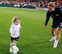 United States defender Christie Rampone (3) plays soccer with her child Rylie Cate after the game. The women's national team of the United States defeated Canada 6-0 during an international friendly at Robert F. Kennedy Memorial Stadium in Washington, D. C., on May 10, 2008.