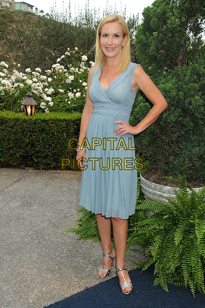 Angela Kinsey<br /> 6th Annual Oceana SeaChange Gala held at a Private Villa, Laguna Beach, California, USA. <br /> August 18th, 2013<br /> full length dress hand on hip blue sleeveless <br /> CAP/ADM/BP<br /> &copy;Byron Purvis/AdMedia/Capital Pictures