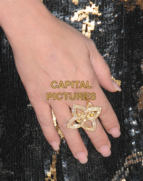 VIRGINIA MADSEN .attends The 30th Anniversary Carousel of Hope Ball Presented by Mercedes-Benz held at The Beverly Hilton Hotel in Beverly Hills, California, USA,.October 25th 2008..detail gold flower ring  hand .CAP/DVS.©Debbie VanStory/Capital Pictures