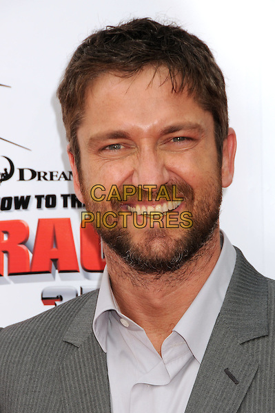 "GERARD BUTLER.""How To Train Your Dragon"" Los Angeles Premiere held at the Gibson Amphitheatre, Universal City, California, USA, 21st March 2010..arrivals portrait headshot smiling pinstripe grey gray suit shirt beard facial hair teeth .CAP/ADM/BP.©Byron Purvis/AdMedia/Capital Pictures."