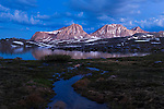 Pre dawn light on Merriam peak, Royce peak and Feather Peak above French Lake in the High Sierra mountains near French Canyon and Pine Creek Pass.