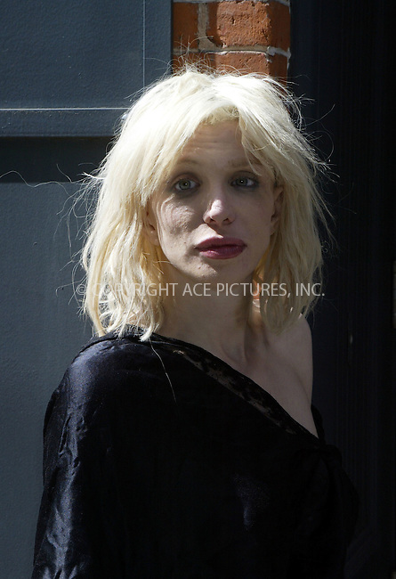 Following a week of controversial behaviour, singer Courtney Love ventured out of her SoHo loft  building to face waiting photographers. After a five minute 'fashion-shoot' style photo-session she slipped back into the building. Love also sported a nasty bruise on her neck. New York City, March 22 2004. Please byline: ACE Pictures.   ..*PAY-PER-USE*      ....IMPORTANT: Please note that our old trade name, NEW YORK PHOTO PRESS (NYPP), is replaced by our new name, ACE PICTURES. New York Photo Press and ACE Pictures are owned by All Celebrity Entertainment, Inc.......All Celebrity Entertainment, Inc:  ..contact: Alecsey Boldeskul (646) 267-6913 ..Philip Vaughan (646) 769-0430..e-mail: info@nyphotopress.com