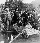 La famille Hugo dans le jardin de Hauteville House lors de l'exil a Guernesey (1855-1870) pres de la fontaine aux serpents c. 1860 : Victor Hugo (g), derriere : ses 2 fils Charles Hugo (1826-1873) et Francois Victor Hugo (1828-1873) ; assise au c : Adele Foucher (sa femme) ; a d : Auguste Vacquerie ; assise par terre : sa fille Adele Hugo (1830-1915)  ---  Hugo's family at Hauteville House, during exile in Guernesey c. 1860 :  Victor Hugo (l), behind : his sons Charles Hugo (1826-1873) et Francois Victor Hugo (1828-1873) ; seated in c : Adele Foucher (his wife) ; on r : Auguste Vacquerie ; on the ground : Adele Hugo (his daughter)