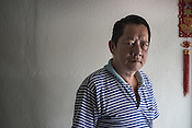 60 year old Cheng Ah Kow, a former pig farmer and a  survivor of the Nipah virus poses for a portrait in his house in Bukit Pelandok in Nageri Sembilan, Malaysia on October 16th, 2016. <br /> In September 1998, a virus among pig farmers (associated with a high mortality rate) was first reported in the state of Perak in Malaysia. Dr. Chua investigated and discovered the virus and it was later named, Nipah Virus. The outbreak in Malaysia was controlled through the culling of &gt;1 million pigs.