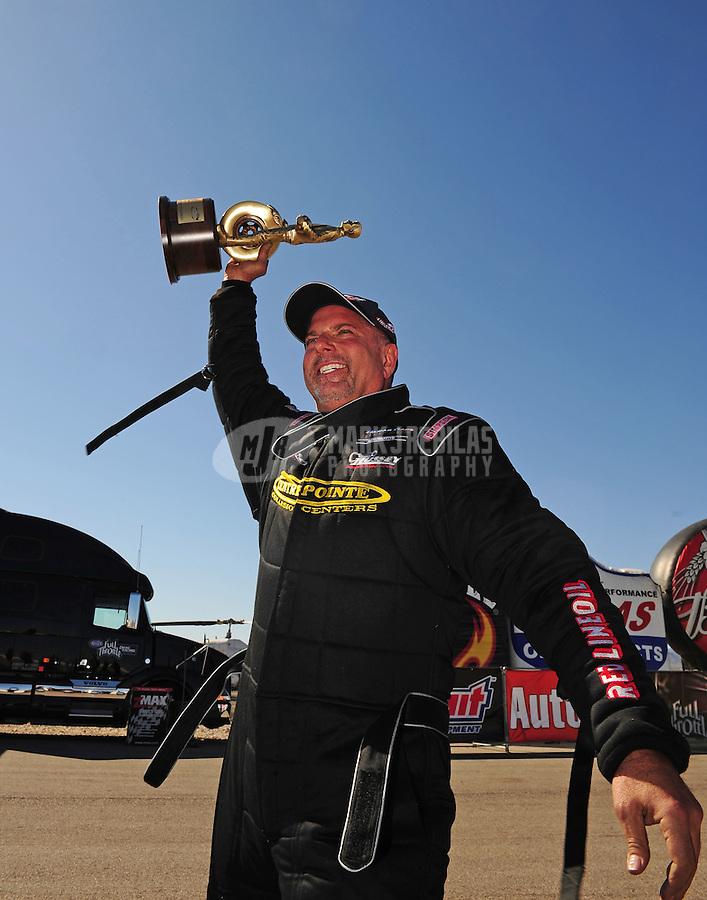 Apr. 5, 2009; Las Vegas, NV, USA: NHRA top alcohol funny car driver Tony Bartone after winning the Summitracing.com Nationals at The Strip in Las Vegas. Mandatory Credit: Mark J. Rebilas-