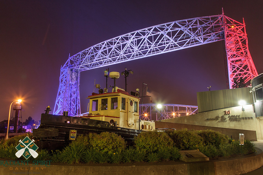 Tug &quot;Bayfield&quot; on Independence Day<br /> The retired tugboat, Bayfield, looked festive for Independence Day celebrations. The Aerial Lift Bridge was decked out in red, white, and blue for the occasion.<br /> <br /> The Aerial Lift Bridge is one of the most-recognized iconic landmarks of Duluth. In a mere 55 seconds, the bridge rises to 138 feet, making it the quickest and biggest lift bridge in the world.