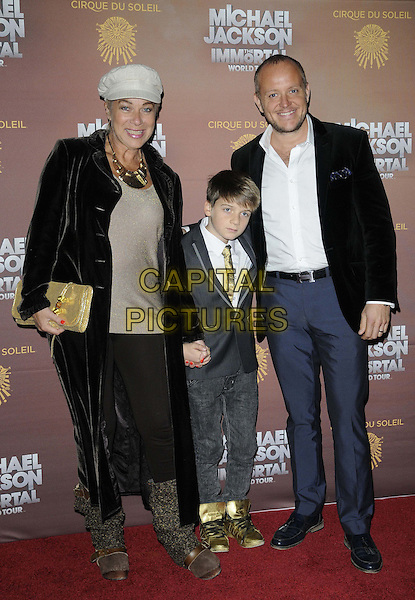 Denise Welch & Lincoln Townley.attended the Cirque Du Soleil 'Michael Jackson: The Immortal World Tour' European premiere, The O2 Arena, Peninsula Square, London, England, UK, 12th October 2012..full length black jacket brown velvet coat gold clutch bag jeans suit blazer white shirt cap hat .CAP/CAN.©Can Nguyen/Capital Pictures.