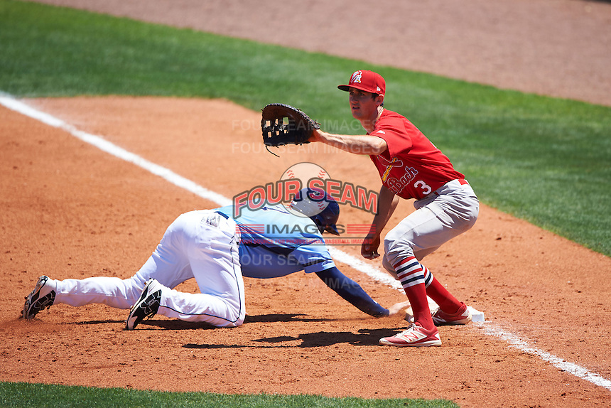 Palm Beach Cardinals first baseman Danny Diekroeger (3) waits for a throw as Riley Unroe (7) dives back to first during a game against the Charlotte Stone Crabs on April 10, 2016 at Charlotte Sports Park in Port Charlotte, Florida.  Palm Beach defeated Charlotte 4-1.  (Mike Janes/Four Seam Images)