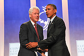 United States President Barack Obama, right, shakes hands with former U.S. President Bill Clinton, left, at the Clinton Global Initiative following a conversation about health care in New York, New York on Tuesday, September 24, 2013.<br /> Credit: Allan Tannenbaum / Pool via CNP