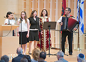 Several hundred people gather Sunday, April 23, 2017 at Washington, DC's Adas Israel Congregation to commemorate Yom Hashoah, Holocaust Remembrance Day, with the synagogue's annual Garden of the Righteous ceremony, honoring non-Jews who risked their lives to save Jews during the Holocaust. This year's honoree was the Veseli family from Albania, who sheltered two Jewish families in Kruja, Albania during World War II.  At the ceremony, Albanian folk musicians Raif Hyseni (far right) and Merita Halili are joined by (L to R) Ana Susskind, Jennifer Nehrer, Rochelle Berman and Cantor Arianne Brown of Adas Israel Congregation.<br /> Credit: Ron Sachs / CNP