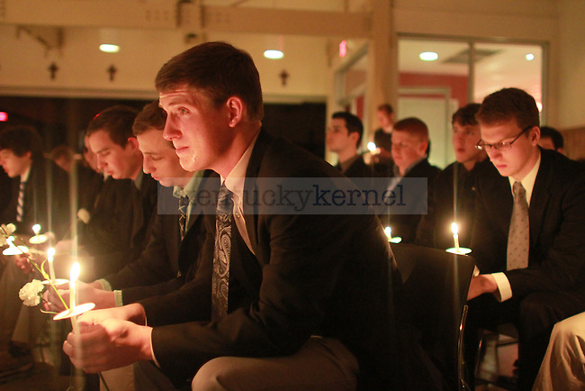 A Delta Sigma Phi fraternity brother cries during the Candlelight Vigil for Alex Ehr in the Newman Center in Lexington, Ky., on 2/23/12. Photo by Brandon Goodwin | Staff