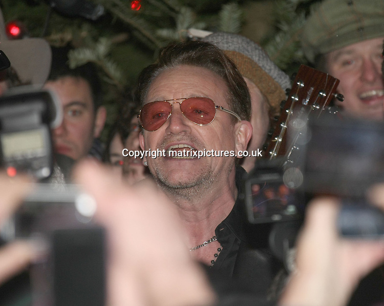 NON EXCLUSIVE PICTURE: MATRIXPICTURES.CO.UK<br /> PLEASE CREDIT ALL USES<br /> <br /> WORLD RIGHTS EXCEPT IRELAND<br /> <br /> Irish U2 frontman Bono is pictured busking on the streets of Dublin on Christmas Eve.<br /> <br /> During the afternoon, Bono joined his friends Glen Hansard from Once the film and the musical and The Frames, Liam O' Maonlai from The Hothouse Flowers, Irish singer-songwriter Mundy and many more.<br /> <br /> Together they were raising money for The Simon Community. <br /> <br /> Bono turned up at 5.30pm to sing 2 songs, Merry Christmas &amp; Come On All Ye Faithful. About 800 to 1,200 people watched the sing along.<br /> <br /> DECEMBER 24th 2013<br /> <br /> REF: MDE 138077
