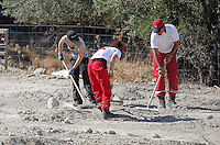 FAO JANET TOMLINSON, DAILY MAIL PICTURE DESK<br /> Pictured: Red Cross volunteers search a field in Kos, Greece. Sunday 02 October 2016<br /> Re: Police teams led by South Yorkshire Police, searching for missing toddler Ben Needham on the Greek island of Kos have moved to a new area in the field they are searching.<br /> Ben, from Sheffield, was 21 months old when he disappeared on 24 July 1991 during a family holiday.<br /> Digging has begun at a new site after a fresh line of inquiry suggested he could have been crushed by a digger.