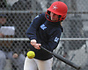 Ashley Budrewicz #4 of MacArthur drives a pitch during a non-league varsity softball game against Massapequa at MacArthur High School on Tuesday, March 20, 2018. She went 2-4 with two doubles, an RBI and a run scored in MacArthur's 3-0 win.