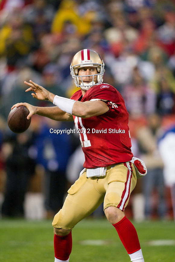 San Francisco 49ers quarterback Alex Smith (11) throws a pass during an NFC Championship NFL football game against the New York Giants on January 22, 2012 in San Francisco, California. The Giants won 20-17 in overtime. (AP Photo/David Stluka)