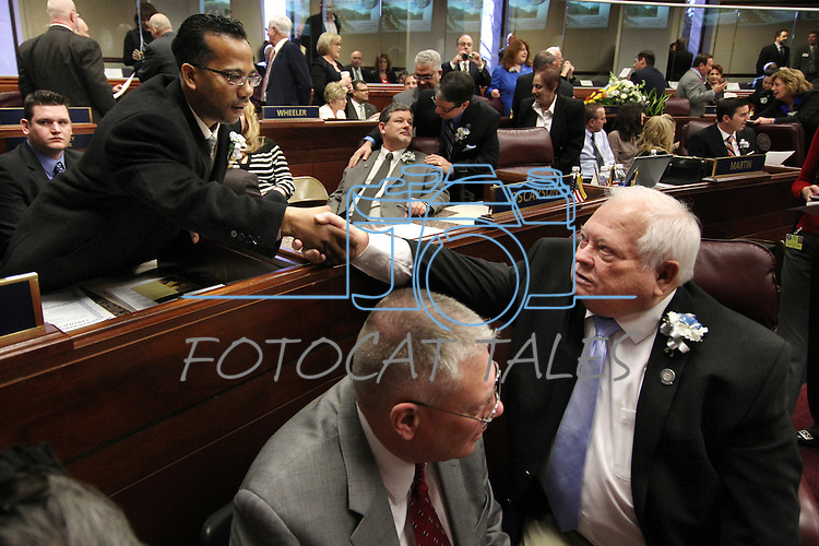 Embattled Nevada Assemblyman Steven Brooks, D-North Las Vegas, left, is greeted by Assemblyman Pete Livermore, R-Carson City, during the opening day of the 77th Legislative Session in Carson City, Nev. on Monday, Feb. 4, 2013. Brooks was arrested Jan. 19 and accused of threatening incoming Democratic Speaker Marilyn Kirkpatrick. (AP Photo/Cathleen Allison)