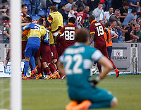 Calcio, Serie A: Lazio vs Roma. Roma, stadio Olimpico, 25 maggio 2015.<br /> Roma's Mapou Yanga-Mbiwa is hidden by teammates' hugs after scoring the winning goal as Lazio's goalkeeper Federico Marchetti, bottom, reacts during the Italian Serie A football match between Lazio and Roma at Rome's Olympic stadium, 25 May 2015. Roma won 2-1.<br /> UPDATE IMAGES PRESS/Riccardo De Luca