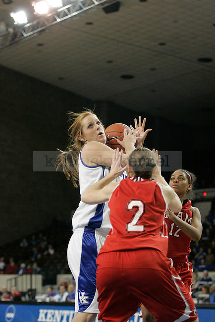 UK's Anna Cole looks to put the ball up against Miami (OH) Tuesday night at Memorial Coliseum. Photo by Scott Hannigan | Staff.