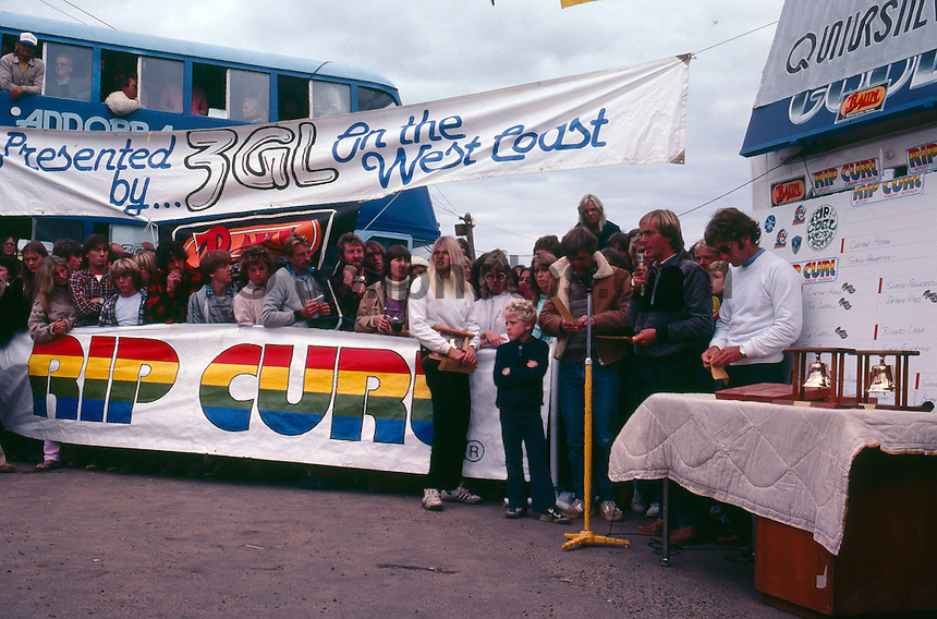 Bells Beach, Torquay, Victoria, Australia. The presentation of the Rip Curl Bells Beach Easter Classic 1981 with  Pam Burridge (AUS), Rod Brooks (AUS), Quiksilver founder John Law (AUS) and Surfing Australia's Alan Atkins (AUS). Judge Al Hunt (AUS) is in the window of the bus..Photo: joliphotos