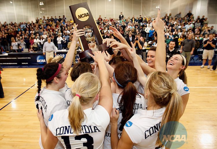 05 DEC 2009: Concordia University players celebrate with the NCAA Trophy after beating West Texas A&M University during the Division II Women's Volleyball Championship held at the Gangelhoff Center on the campus of Concordia University in St. Paul, MN.  Concordia defeated West Texas A&M 3-0 for the national title.  Carlos Gonzalez/NCAA Photos