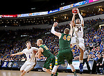 SIOUX FALLS, SD - MARCH 10: Cody Larson #34 from South Dakota State shoots a jumper over Dexter Werner #40 from North Dakota State in the first half of the Summit League Championship Tournament game Tuesday at the Denny Sanford Premier Center in Sioux Falls, SD. (Photo by Dave EggenInertia)