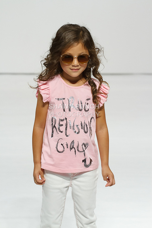 Child model walks runway in an outfit from the True Religion Kids collection, during petitePARADE Spring Summer 2018 with Children's Club, at the Javits Center on August 6, 2017.