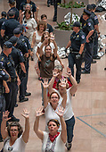 "Protestors wave their hands in the air as they are led out of the atrium of the Hart Senate Office Building by United States Capitol Police during the ""Women's March in Civil Disobedience to End Family Detention"" in  in Washington, DC on Thursday, June 28, 2018.  <br /> Credit: Ron Sachs / CNP<br /> (RESTRICTION: NO New York or New Jersey Newspapers or newspapers within a 75 mile radius of New York City)"