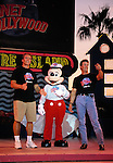 Arnold Schwarzenegger and Sly Stallone. with Mickey Mouse.Attending the Planet Hollywood Ground Breaking Ceremony at Pleasure Island, Walt Disney World.in  Orlando Florida..November 11, 1993.