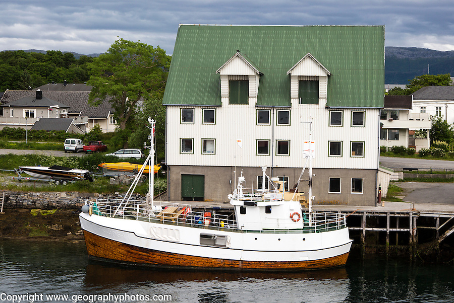 Boat outside waterside building, Bronnoy,  Bronnoysund, Nordland, Norway