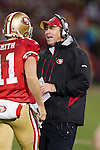 San Francisco 49ers assistant coach Geep Chryst talks to quarterback Alex Smith (11) during an NFC Championship NFL football game against the New York Giants on January 22, 2012 in San Francisco, California. The Giants won 20-17 in overtime. (AP Photo/David Stluka)