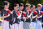 Suffield little league players hold their caps to their hearts in honor of high school senior, Seventeen-year-old Brianna Mailloux, who died Thursday in a traffic accident on I-91 in Windsor,   Saturday, April 21, 2018, during the opening day of Suffield little league. (Jim Michaud / Journal Inquirer)