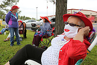 Kathie Williams, a member of the Red Hat Hotties, sits with other members Wednesday, May 20, 2020, outside in front of the Rogers Adult Wellness Center in Rogers. The social group would normally meet inside the center but it is closed do to the covid-19 pandemic. The group has decided to meet every other Wednesday for lunch and a visit outside the center. Check out nwaonline.com/200521Daily/ and nwadg.com/photos for a photo gallery.<br /> (NWA Democrat-Gazette/David Gottschalk)