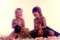 Young girl and boy in Hawaiian dress with Ipu (Hawaiian musical implement)
