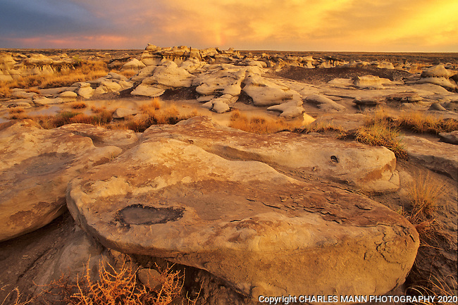 A dramatic sunset after a storm at the Bisti Wilderness Area near Farmington, New Mexico