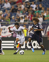 Pumas UNAM forward Martin Bravo (10) dribbles as New England Revolution defender Kevin Alston (30) defends. The New England Revolution defeated Pumas UNAM in SuperLiga group play, 1-0, at Gillette Stadium on July 14, 2010.