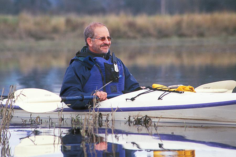 Man in sea kayak on Snohomish River, Washington